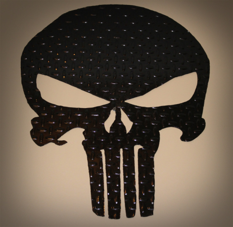 Punisher skull wall art on tread plate painted black